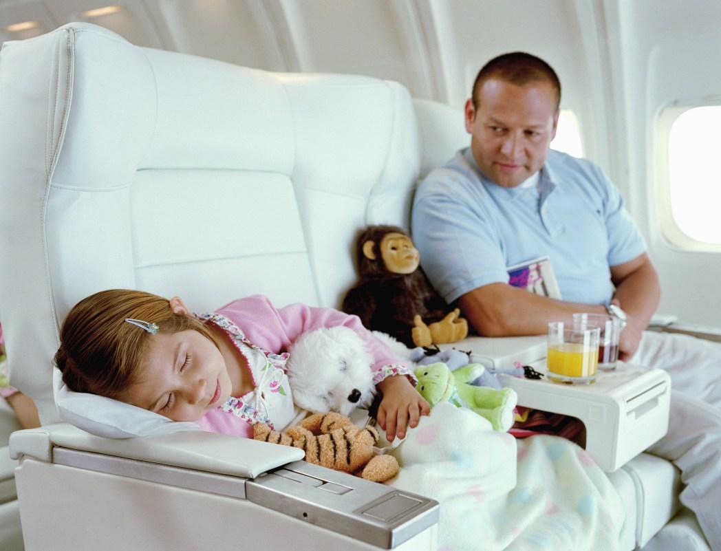 Girl sleeps on plane