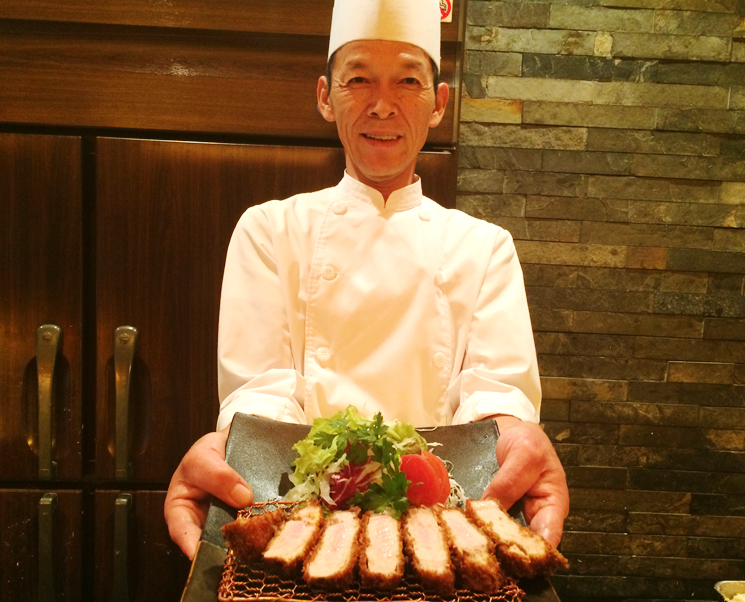 chef showing fried pork