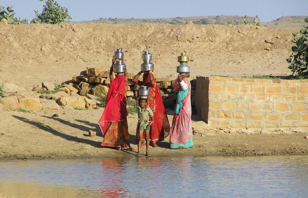 desert people carrying water
